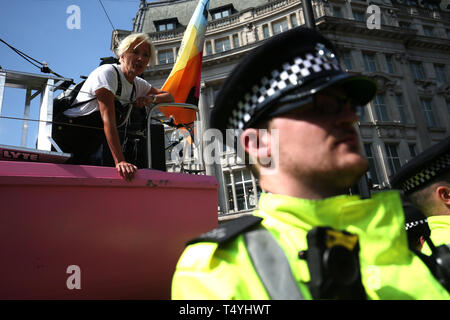 Police surround the Extinction Rebellion boat as Emma Thomspon (left) joins demonstrators at Oxford Circus in London. - Stock Image