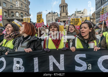 London, UK. 9th Dec, 2018. People chant at the start of the united counter demonstration by anti-fascists in opposition to Tommy Robinson's fascist pro-Brexit march. The march which included both remain and leave supporting anti-fascists gathered at the BBC to to to a rally at Downing St. Police had issued conditions on both events designed to keep the two groups well apart. Credit: Peter Marshall/Alamy Live News - Stock Image
