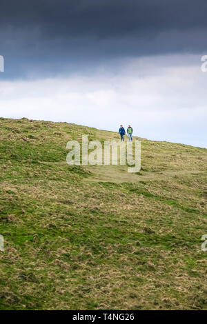 People enjoying a walk over Pentire Point East in Newquay in Cornwall. - Stock Image