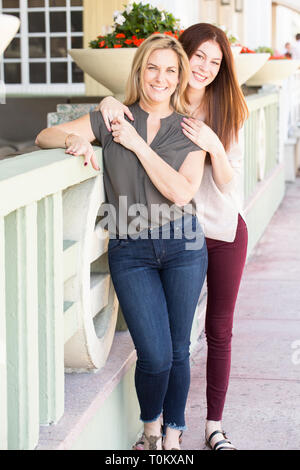 Latin mother and teen daughter. - Stock Image