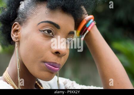 Closeup of beautiful African woman face. - Stock Image