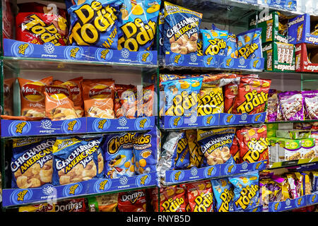 Cartagena Colombia Old Walled City Center centre Getsemani convenience store inside junk snack food display sale chips crisps Cheetos cracklings packa - Stock Image