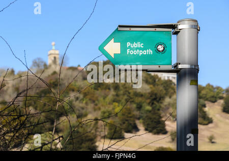 Public Footpath sign with West Wycombe Hill in the background, West Wycombe, Buckinghamshire, England, UK. - Stock Image