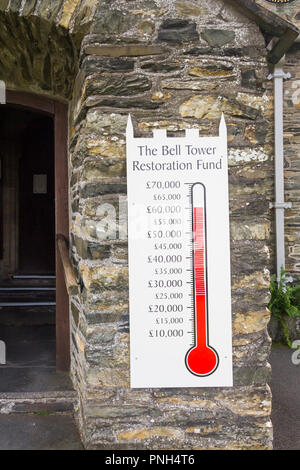 Bell tower restoration fund raising amount raised indicator at the entrance to the parish church at Hawkshead Cumbria. - Stock Image