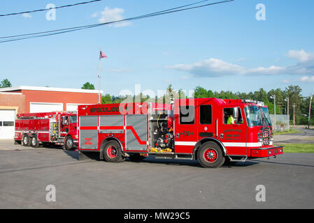 Two fire engines from the Speculator Volunteer Fire Department, in Speculator, NY USA, driving out on a training exercise. - Stock Image