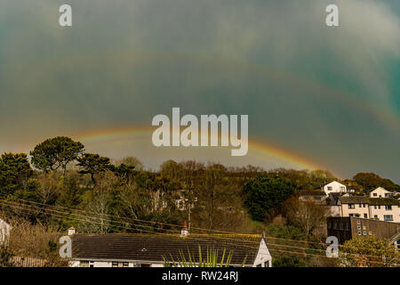 Mousehole, Cornwall, UK. 4th March 2019. UK Weather Hail showers and rainbows over Mousehole this afternoon. Credit: Simon Maycock/Alamy Live News - Stock Image