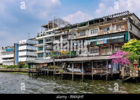 Riverside buildings in the Chao Praya River in Bangkok in Thailand - Stock Image