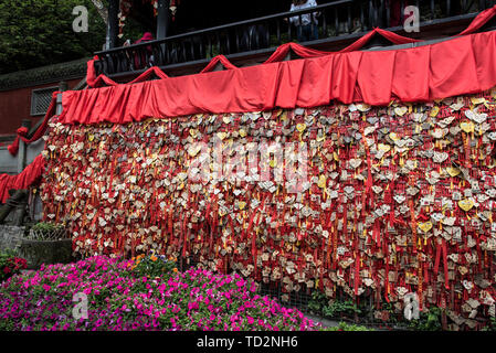 Chinese Love charms covering the temple's wall at the Dujiangyan city temple building at the irrigation site, China, Sichuan Province - Stock Image