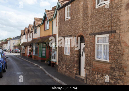 Lime Street in Nether Stowey. Terrace of Victorian houses next to a much older stone cottage. - Stock Image