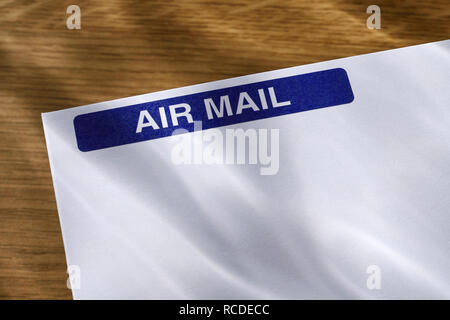 An Air Mail sticker on a white envelope - Stock Image