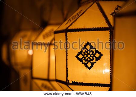 Thai yellow paper street lantern on street decoration during Loy Krathong and Yi Peng - Stock Image