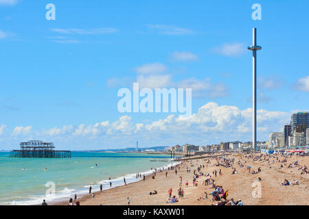 Side-view of Brighton seafront featuring British Airways 1360 viewing tower and remains of West pier. - Stock Image