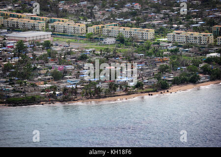 Blue, plastic tarps cover damage roofs during relief efforts in the aftermath of Hurricane Maria October 29, 2017 - Stock Image