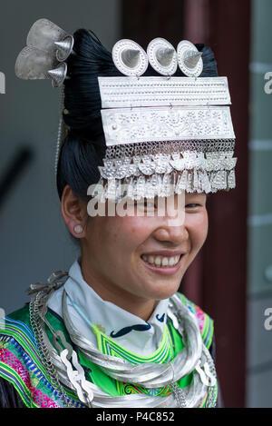 Women wearing large silver hair pieces, Xiaoao Miao ethnic minority village Jiarong, Libo, Guizho Province, China - Stock Image