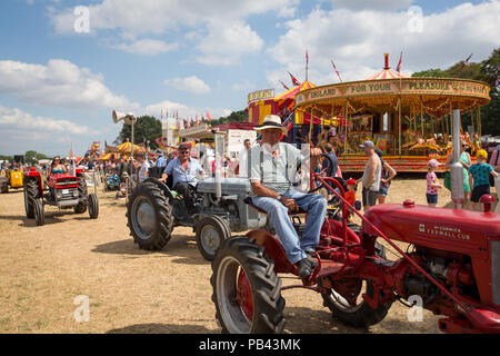A convoy of vintage tractors on display at the 2018 Cheshire Steam Fair - Stock Image