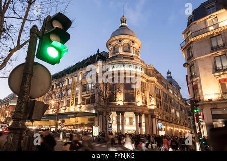 Paris France Printemps department store left bd Hausmann at dusk Galerie Lafayette - Stock Image