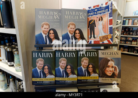 Hardcover nonfiction books about Prince Harry and Meghan Markle 2018 in a bookstore, Vancouver, BC, Canada - Stock Image