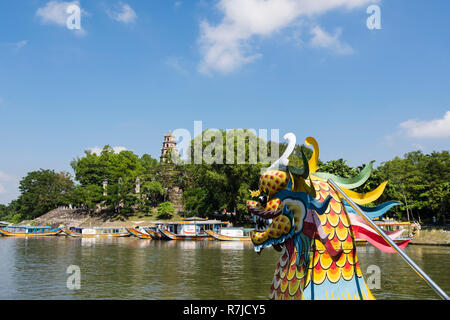 View of Thien Mu Pagoda from a tourists' dragon boat sailing on the Perfume River. Hue, Thua Thien–Hue Province, Vietnam, Asia - Stock Image
