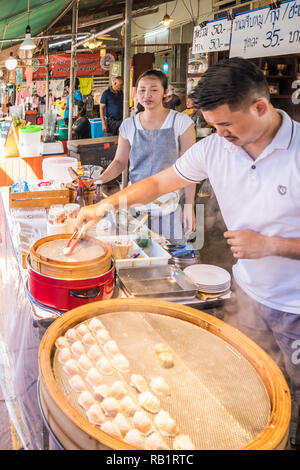 Amphawa, Thailand - 7th October 2018: Making chinese dumplings for sale, A floating market is held every weekend. - Stock Image