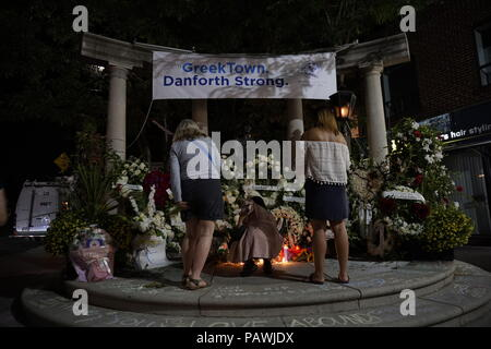 Toronto, Canada. 25th July 2018. People attend candle light vigil in Greek Town on Danforth Avenue where victims were shot by gunman on July 22, 2018. Flowers, candles and messages are everywhere Credit: CharlineXia/Alamy Live News - Stock Image
