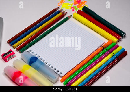 Notepad and stationery on desctop. Text space, copy space. - Stock Image