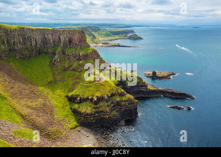 The Amphitheatre, Port Reostan Bay and Giant's Causeway on background, County Antrim, Northern Ireland, UK - Stock Image