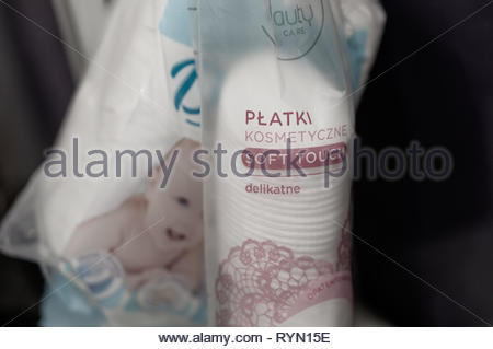 Poznan, Poland - March 8, 2019: Close up of cotton pads in a plastic bag in soft focus. - Stock Image