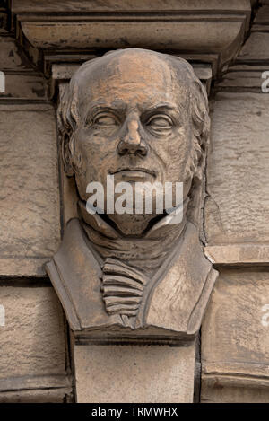 The Edinburgh Phrenological Society's former museum in Chambers Street, Edinburgh bears sculpted portraits of prominent figures in phrenology. - Stock Image