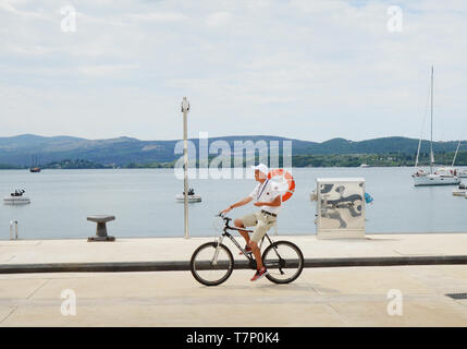 Cycling in Tivat's Porto Montenegro. - Stock Image