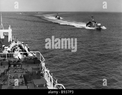 A joint cruising of Grozny formidable missile cruiser and Cuban missile fastboats - Stock Image
