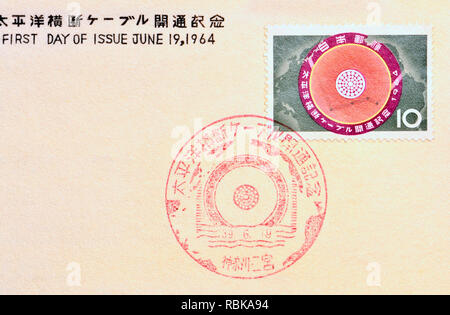 Japanese postage stamp (1964) - Opening of the transpacific cable. - Stock Image