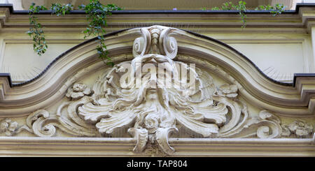 Detail from an Art Nouveau (Jugendstil) style in Wiesbaden, the state capital of Hesse, Germany. The sculpture depicts a man's face. - Stock Image