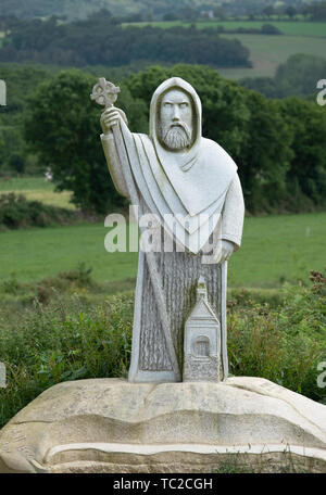 St Leg granite sculpture in the Valley of the Saints, Quenequillec, Brittany, France. - Stock Image