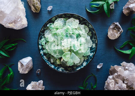Green Fluorite and Quartz on Blue Table - Stock Image