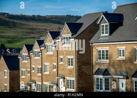 Modern affordable homes built from Peak District stone in Buxton, England. - Stock Image