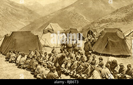 Group of men and boys camping at Lingzhi, Bhutan, South Asia. They are 15,000 feet up in the Himalayas. - Stock Image