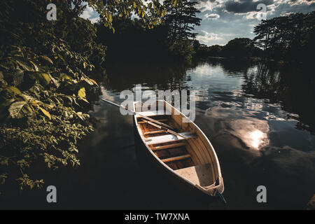 a boat on the water at the park in laxenburg near vienna austria in summer - Stock Image