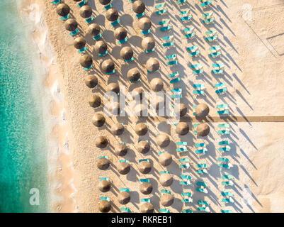 Sunchairs and umbrellas on the beach at Porto Vathy Beach, Thasos Island, Greece - Stock Image