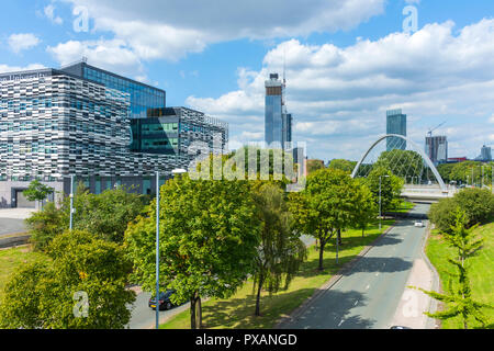 The Brooks Academic building, the Deansgate Square towers and the Beetham and Axis towers from a bridge over Princess Road, Manchester, England UK. - Stock Image
