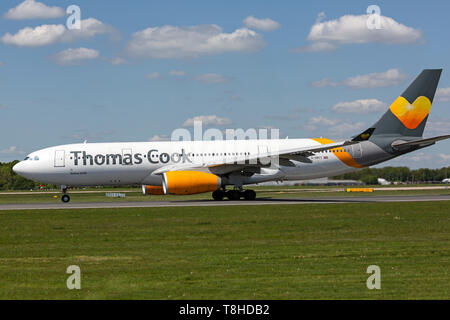 Thomas Cook airlines Airbus A330, registration G-OMYT, preparing for take off at Manchester Airport, England. - Stock Image