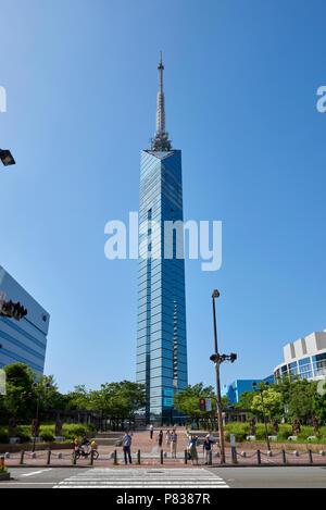 Fukuoka Tower on a blue sky day, seeing from Momochi Central Park, Hakata Bay, Momochihama, Japan. - Stock Image