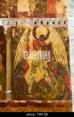 Detail of gothic mural painting representing Saint Michael Archangel against a demon in Santa María de Iguácel church (Larrosa, Huesca, Aragón, Spain) - Stock Image