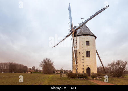 Windmill in the French village Les Trois-Moutiers, Vienne, Nouvelle-Aquitainne, France - Stock Image