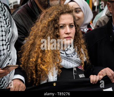 London, UK. 1th May 2019. Palestinian teenage activist Ahed Tamimi holds the banner at the front of the march from the BBC to a rally in Whitehall a few days before Nakba day showing solidarity with the Palestinian people and opposing continued Israel violation of international law and human rights. The protest called for an end to Israeli oppression and the siege of Gaza and for a just peace that recognises Palestinian rights including the right of return. It urged everyone to boycott and divest from Israel and donate to medical aid for Palestine. Peter Marshall/Alamy Live News Credit: Peter - Stock Image