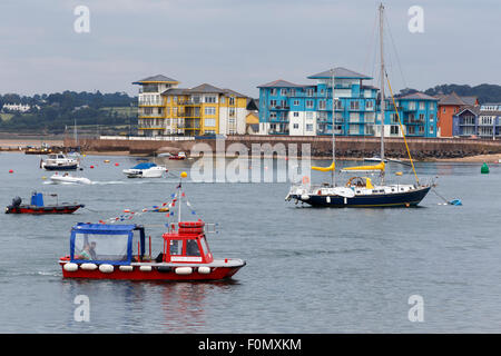 Red & blue 'water taxi' ferrying passengers to Dawlish Warren from Exmouth - Stock Image