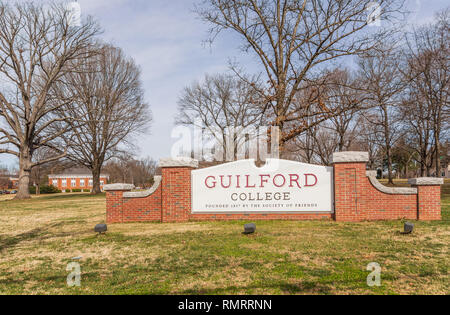 GREENSBORO, NC, USA-2/14/19: The entrance sign for the campus of Guilford College, founded by the Quakers in 1837. - Stock Image