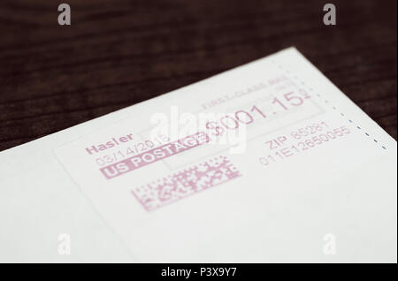 Envelope with QR Quick Response code on postage, USA - Stock Image