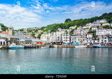 6 June 2018: Looe, Cornwall, UK - The small coastal town of Looe, with the River Looe and hillside houses. - Stock Image