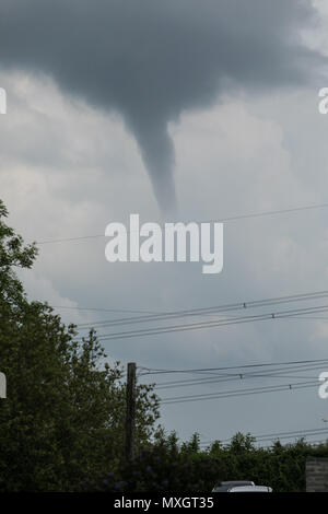 Pembrokeshire, Wales, UK. 4th Jun, 2018. A Tornado / funnel cloud spotted in Pembrokeshire around lunchtime on the 4th June 2018. Touched down in fields near to Neyland, Pembrokeshire, Wales, UK Credit: Drew Buckley/Alamy Live News - Stock Image