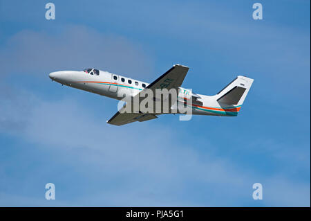 French registered Cessna Citation 550 II  F-GLTK climbing out from Inverness Dalcross Airport in the Scottish Highlands. - Stock Image
